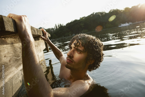 germany, berlin, young man in spree river, side view