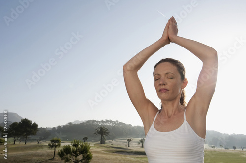 spain, mallorca, woman excercising yoga