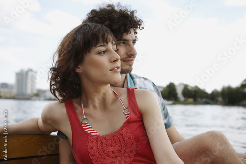 germany, berlin, young couple on motorboat, portrait