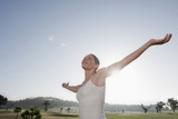 spain, mallorca, woman with arms outstretched, side view, portrait