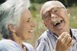 Spanien, Mallorca, Senioren Paar, Frau kitzeln Mann mit Grashalm, lachen, Portrait, close-up