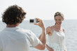 spain, mallorca, man taking a photograph of a woman