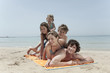 spain, mallorca, family lying on beach