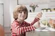 Deutschland, Junge essen Spaghetti, Portrait, close-up