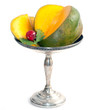 cut mango on sterling silver dish