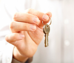Man holding key. Shallow DOF, focus on key