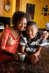 African-American woman and teen in kitchen