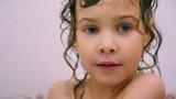 portrait of cute little girl in bathroom