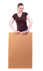 smiling young woman keeping cork board, isolated.