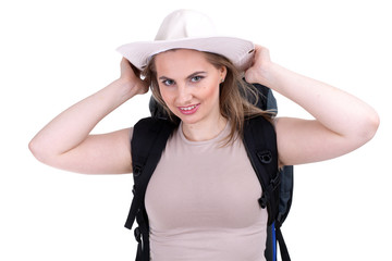 young female tourist with white hat and backpack