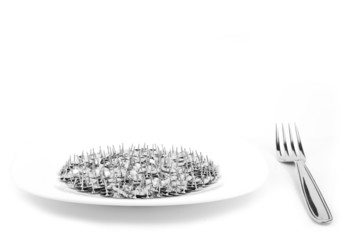 Dish with thumbtack and fork isolated on white. fake