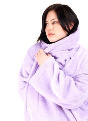 thoughtful, young, black hair woman in bathrobe