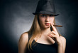 The woman in a hat and with a cigar