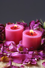 Two Red Candle and red Roses petals