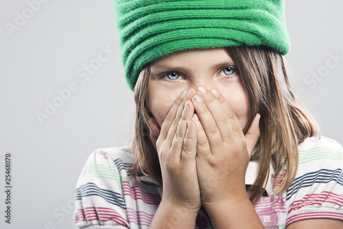 Cute Child Covering her Mouth and Nose