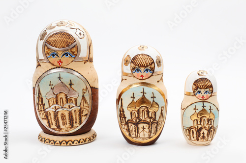 Three Russian Babushka Dolls over white background