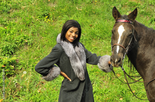 woman posing with a horse
