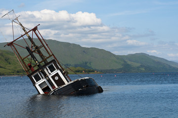Partially submerged fishing vessel in Loch Linnie