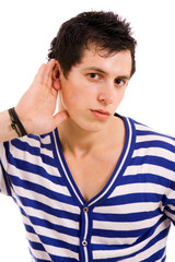 young man with open hand gesturing hearing something on white ba