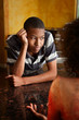 African-American young man and woman talking in kitchen