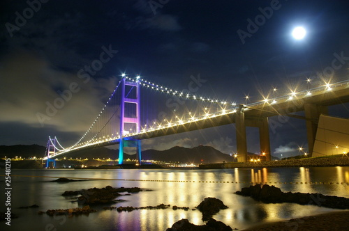 Tsing Ma Bridge in Hong Kong at night, with moon