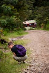 Hiker along side a rugged road in Costa Rica