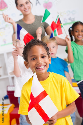 young british boy with diverse classmates in background