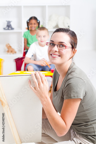portrait of beautiful young preschool teacher