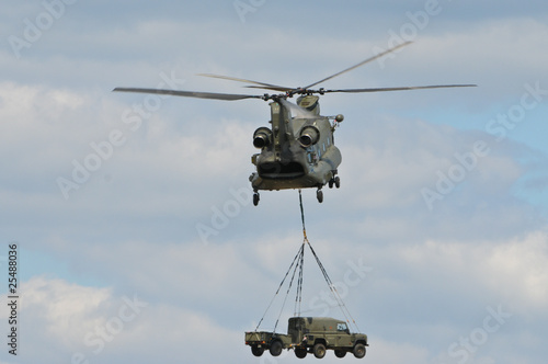 Fotobehang Helicopter Chinook Helicopter transporting Car