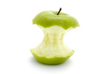 green apple core over white