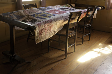 Old House interior with Quilt on the Table