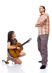 girl plays the guitar for a boy