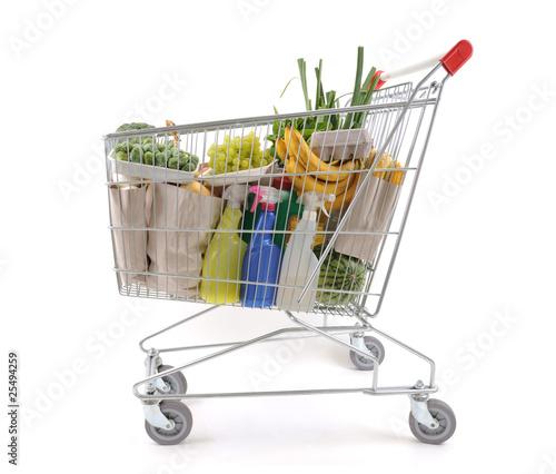 Keuken foto achterwand Boodschappen Shopping trolley full of grocery isolated on white background.