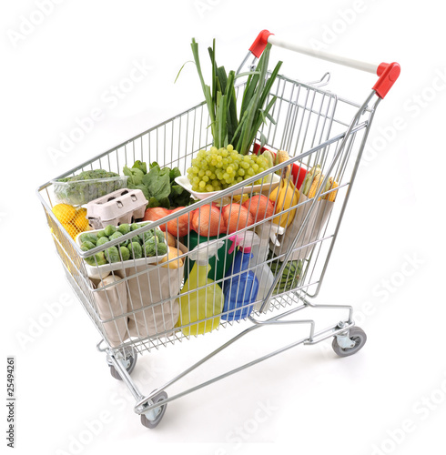 Papiers peints Au marche Shopping trolley full of grocery isolated on white background.