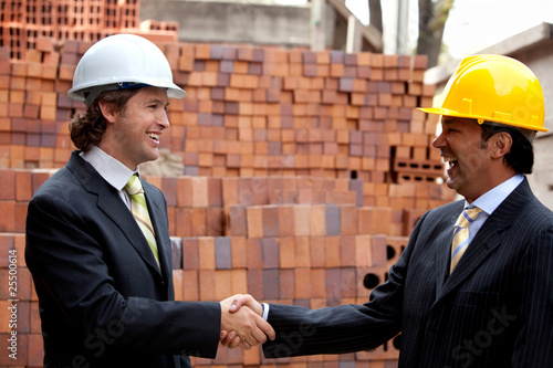 Engineers shaking hands