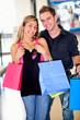 Happy couple shopping