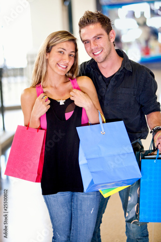 Happy couple shopping