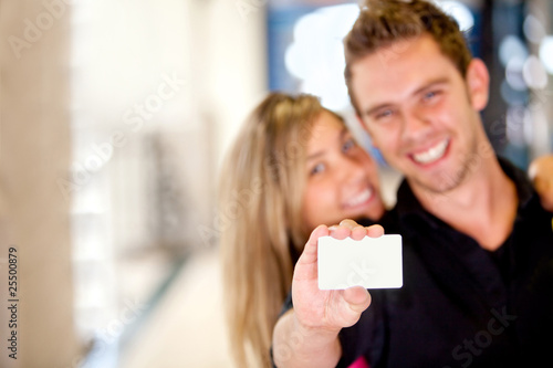 Couple displaying a card