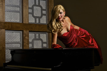 Film Noir Starlet Lying on a Piano