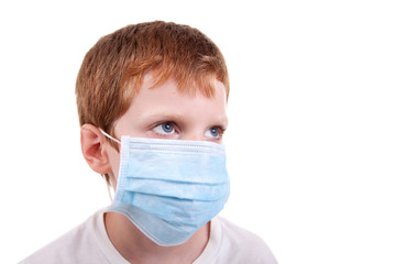 young boy with a medical mask
