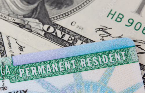 Photo: USA Permanent Resident card aka Green Card and paper money