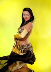 Beautiful dancer woman in bellydance costume with pretty profess