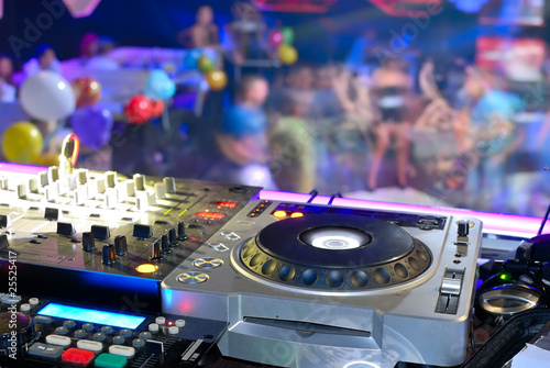 DJ's deck abothe the dancefloor