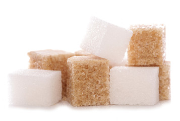 Mixture of brown and white sugar cubes