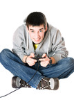 Young man with a joystick for game console poster