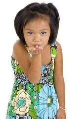 little girl blowing a kiss