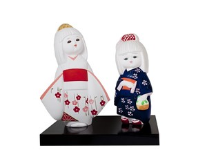 dolls of two young japanese girls