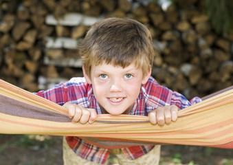 Young boy posing on a hammock
