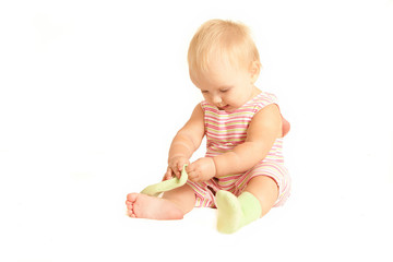 cute young baby play with own socks