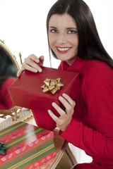 Attractive younf woman with Christmas presents